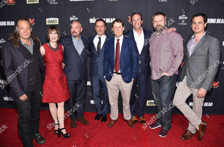 """Director/executive producer Greg Nicotero, and from left, executive producer Gale Anne Hurd, Joel Stillerman, Andrew Lincoln, executive producer Scott M. Gimple, Charlie Collier, president/general manager of AMC, and executive producers Robert Kirkman and Dave Alpert attend the season five premiere of """"The Walking Dead"""" at AMC Universal Citywalk, in Universal City, Calif"""