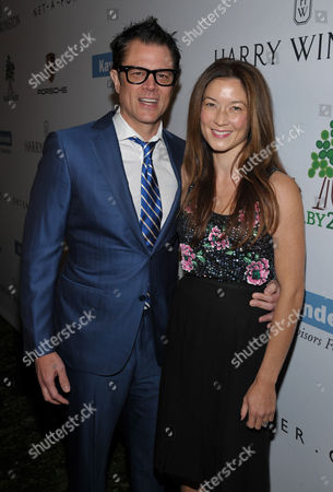 Johnny Knoxville, left, and Noami Nelson arrive at the Second Annual Baby2Baby Gala honoring Drew Barrymore, on in Culver City, Calif