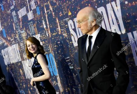 Actress Emma Stone laughs at Larry David on the red carpet at the SNL 40th Anniversary Special at Rockefeller Plaza, in New York