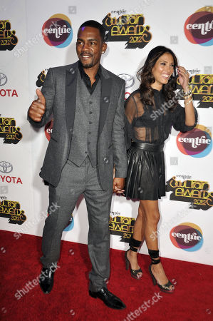 Actor Bill Bellamy, left, and his wife Kristen Baker arrives at the Soul Train Awards at Planet Hollywood Resort and Casino in Las Vegas