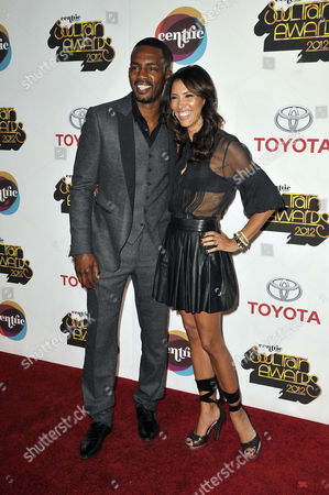 From left, Actor/comedian Bill Bellamy and wife Kristen Baker arrive at the Soul Train Awards at Planet Hollywood Resort and Casino, in Las Vegas