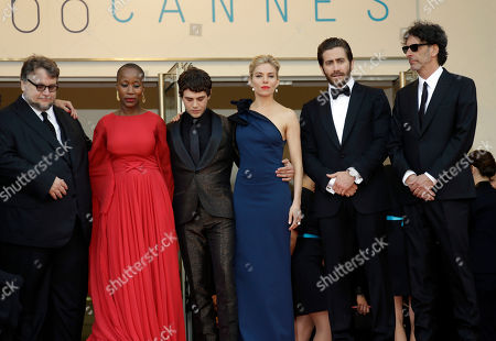 From left, Guillermo Del Toro, Rokia Traore, Xavier Doran, Sienna Miller, Jake Gyllenhaal and Joel Cohen arrive for the opening ceremony and the screening of the film La Tete en Haut (Standing Tall) at the 68th international film festival, Cannes, southern France