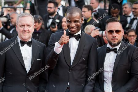 Abd al Malik (center) and unidentified guests arrive for the opening ceremony and for the screening of the film La Tete Haute (Standing Tall) at the 68th international film festival, Cannes, southern France