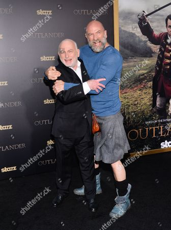 """Actors Gary Lewis, left, and Graham McTavish attend the STARZ mid-season premiere of """"Outlander"""" at the Ziegfeld Theatre, in New York"""