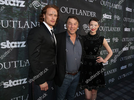 "Sam Heughan, and from left, executive producer Jim Kohlberg and Caitriona Balf arrive at the premiere for the STARZ original series ""Outlander"" during San Diego Comic-Con on in San Diego. ""Outlander"" premieres on STARZ August 9, 2014"