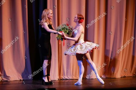 Flesh and Bone creator and executive producer, Moira Walley-Beckett gives roses to ABT principle dancer Gillian Murphy after her performance at the NYC premiere of Starz's original limited series Flesh and Bone at the NYU Skirball Center for the Performing Arts on in New York