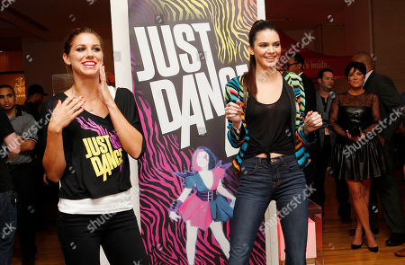 IMAGE DISTRIBUTED FOR UBISOFT -Kris Jenner looks on as Olympic gold medalist Alex Morgan and Kendall Jenner play the Just Dance 4 video game at the Just Dance 4 Fashion Show, in New York