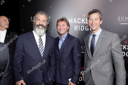 """Director Mel Gibson, Patrick Wachsberger, Co-Chairman, Lionsgate Motion Picture Group, and Erik Feig, President of Production, Lionsgate Motion Picture Group, seen at Summit Entertainment, a Lionsgate Company, Los Angeles Special Screening of """"Hacksaw Ridge"""" at The Academyâ?™s Samuel Goldwyn Theater, in Beverly Hills, Calif"""