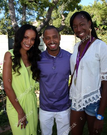 "L-R) Selita Ebanks, Terrence Jenkins and Destinee Hooker of volleyball team USA pose at Robi Reed's 10th Annual ""Sunshine Beyond Summer"" Celebration - The Day Party with a Purpose at the Getty House, in Los Angeles"