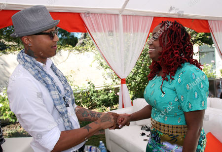 """Stock Image of Jamar Rogers, left, and Ledisi are seen at Robi Reed's 10th Annual """"Sunshine Beyond Summer"""" Celebration - The Day Party with a Purpose at the Getty House, in Los Angeles"""