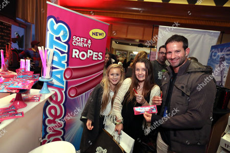 Stock Picture of TV personality Kiptyn Locke, right, and guests are some of the first to taste the new SweeTARTS Ropes, with electrifying bursts of sweet and tart flavors, at KIIS FM's Jingle Ball on in Los Angeles