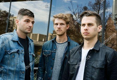 Foster The People's Cubbie Fink, left, Mark Pontius, center, and Mark Foster, pose for a photograph during the SXSW Music Festival, in Austin, Texas
