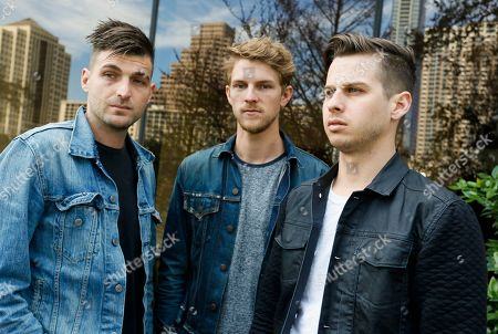 Foster The People's Cubbie Fink, Mark Pontius and Mark Foster, from left, pose for a photograph during the SXSW Music Festival, in Austin, Texas