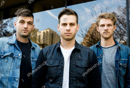 Foster The People's Cubbie Fink, Mark Foster, and Mark Pontius, from left, pose for a photograph during the SXSW Music Festival, in Austin, Texas
