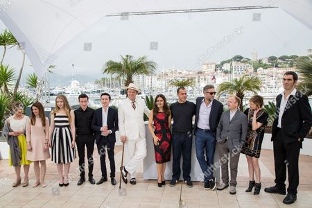Hayley Carmichael, Shirley Henderson, Bebe Cave, Jonah Lees, Christian Lees, John C. Reilly, Salma Hayek, director Matteo Garrone, Vincent Cassel, Toby Jones, Alba Rohrwacher and Guillaume Delaunay, from from left to right pose for photographers during a photo call for the film Tale of Tales, at the 68th international film festival, Cannes, southern France