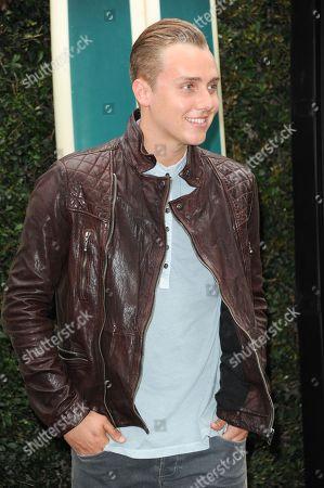 "William Loftis attends the ""Teen Beach Movie"" screening e at event at The Walt Disney studios on in Burbank, Calif"