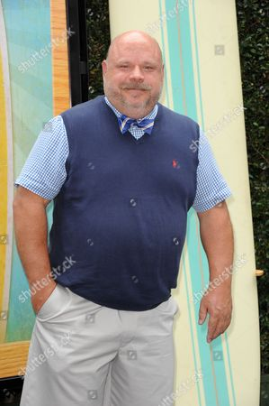 "Stock Image of Kevin Chamberlin attends the ""Teen Beach Movie"" screening e at event at The Walt Disney studios on in Burbank, Calif"