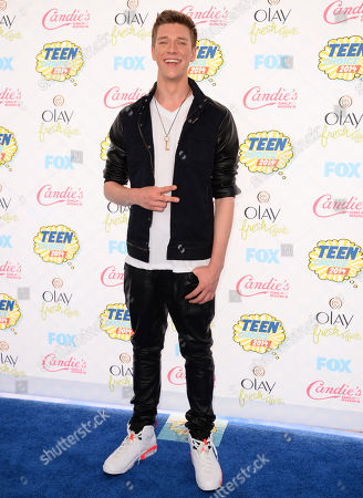 Collins Key arrives at the Teen Choice Awards at the Shrine Auditorium, in Los Angeles