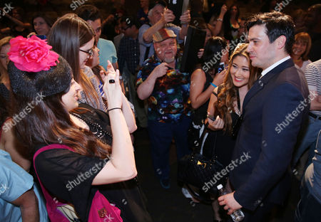 """Actor Robert James-Collier, right, greets fans at An Afternoon with """"Downton Abbey"""" presented by the Television Academy at Paramount Studios, in Los Angeles"""