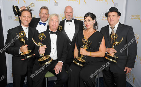 Jason Tregoe, and from left, Christopher Harvengt, Lisa Varztakis, Richard Steele, Bill Bell, and Tim Chilton pose for a portrait at the Television Academy's Creative Arts Emmy Awards at the Nokia Theater L.A. LIVE, in Los Angeles