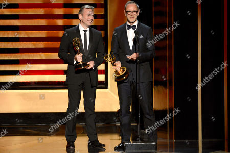 "Tom Broecker and Eric Justian accept the award for outstanding costumes for a variety program or a special for their work on ""Saturday Night Live"" at the Television Academy's Creative Arts Emmy Awards at the Nokia Theater L.A. LIVE, in Los Angeles"
