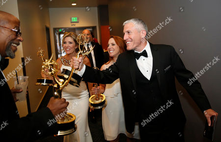Reg E. Cathey, from left, Tava Smiley, Maureen Timpa, Brian Katkin pose backstage at the Television Academy's Creative Arts Emmy Awards at Microsoft Theater, in Los Angeles