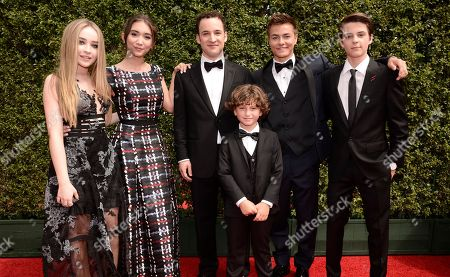 Sabrina Carpenter, from left, Rowan Blanchard, Ben Savage, August Maturo, Peyton Meyer, and Corey Fogelmanis arrive at the Television Academy's Creative Arts Emmy Awards at Microsoft Theater, in Los Angeles