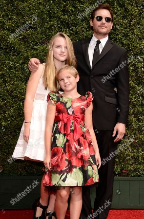 Lola Ray Facinelli, from left, Fiona Eve Facinelli, and Peter Facinelli arrive at the Television Academy's Creative Arts Emmy Awards at Microsoft Theater, in Los Angeles