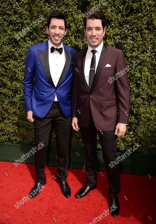 Drew Scott, left, and Jonathan Silver Scott arrive at the Television Academy's Creative Arts Emmy Awards at Microsoft Theater, in Los Angeles