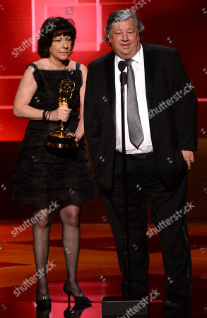 Karen Goodman, left, and Kirk Simon accept the award for outstanding children's program for Alan Alda And The Actor Within You: A YoungArts Masterclass at the Television Academy's Creative Arts Emmy Awards at Microsoft Theater, in Los Angeles