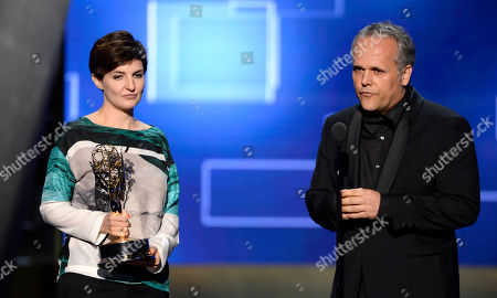 Mathilde Bonnefoy, left, and Dirk Wilutzky accept the award for exceptional merit in documentary filmmaking for their work on Citizenfour at the Television Academy's Creative Arts Emmy Awards at Microsoft Theater, in Los Angeles