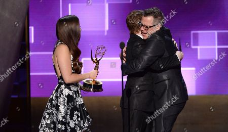 Mae Whitman, left, and Seth Green present Monte C. Haught with the award for outstanding hairstyling for a limited series or a movie for â?oeAmerican Horror Story: Freak Showâ?? at the Television Academy's Creative Arts Emmy Awards at Microsoft Theater, in Los Angeles