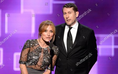 Sasha Alexander, left, and Scott Aukerman speak on stage at the Television Academy's Creative Arts Emmy Awards at Microsoft Theater, in Los Angeles