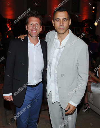 Stock Image of Bill McAdams Jr., left, and Adrian Paul seen at the Television Academy's 67th Emmy Awards Dynamic and Diverse Nominee Reception at the Montage Beverly Hills, in Beverly Hills, Calif