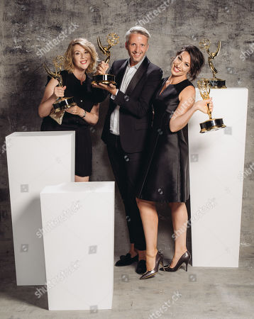 Stock Photo of Kristen Comings, Steven Walberg, Stefanie Mohr poses for a portrait at the Television Academy's 67th Emmy Awards Performers Nominee Reception at the Pacific Design Center on in West Hollywood, Calif
