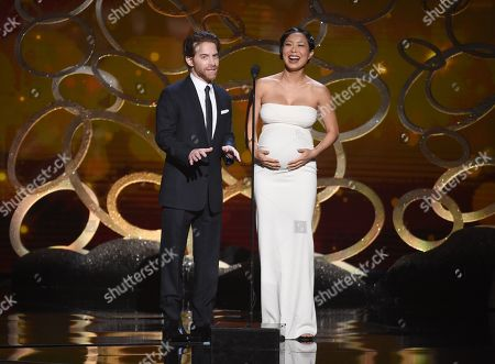 Seth Green, left, and Michelle Ang speak during night two of the Television Academy's 2016 Creative Arts Emmy Awards at the Microsoft Theater on in Los Angeles