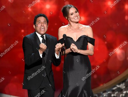 Oscar Nunez, left, and Erinn Hayes speak during night two of the Television Academy's 2016 Creative Arts Emmy Awards at the Microsoft Theater on in Los Angeles
