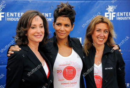 Actress Halle Berry, center, poses with cancer activist Lilly Tartikoff, left, and Julia Goldin, global chief marketing officer of Revlon, at the 20th Annual EIF Revlon Run/Walk For Women on in Los Angeles