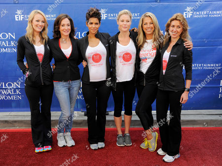 Left to right, Brooke Anderson, Lilly Tartikoff, Halle Berry, Julie Bowen, Denise Austin and Revlon global chief marketing officer Julia Goldin pose together before the 20th Annual EIF Revlon Run/Walk For Women on in Los Angeles