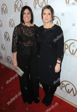 Stock Picture of Pilar Savone, left, and Stacey Sher arrive at the 24th Annual Producers Guild (PGA) Awards at the Beverly Hilton Hotel, in Beverly Hills, Calif