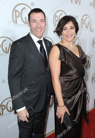 Mark Andrews and Katherine Sarafian arrive at the 24th Annual Producers Guild (PGA) Awards at the Beverly Hilton Hotel, in Beverly Hills, Calif