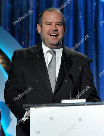 """Marc Shmuger accepts the award for outstanding producer of documentary motion picture for """"We Steal Secrets: The Story of WikiLeaks"""" at the 25th annual Producers Guild of America (PGA) Awards at the Beverly Hilton Hotel, in Beverly Hills, Calif"""