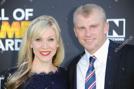 "Ashley Eckstein, left, and David Eckstein arrive at The 3rd Annual Cartoon Network's ""Hall of Game"" Awards at The Barker Hangar on in Los Angeles"