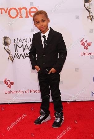 Genis Wooten arrives at the 46th NAACP Image Awards at the Pasadena Civic Auditorium, in Pasadena, Calif