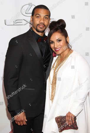 Aaron D. Spears, left, and Estela Spears arrive at the 46th NAACP Image Awards at the Pasadena Civic Auditorium, in Pasadena, Calif