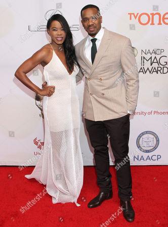 Golden Brooks, left and Duane Martin arrive at the 46th NAACP Image Awards at the Pasadena Civic Auditorium, in Pasadena, Calif
