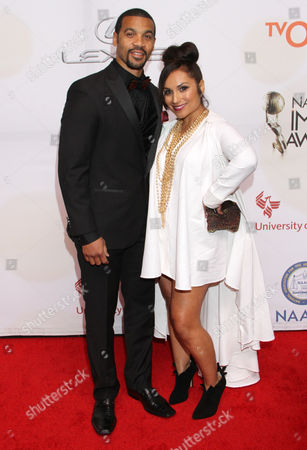 Stock Picture of Aaron D. Spears, left, and Estela Spears arrive at the 46th NAACP Image Awards at the Pasadena Civic Auditorium, in Pasadena, Calif
