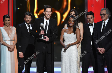 Stock Photo of Show creator Peter Nowalk, center, and the cast and crew of How to Get Away with Murder accept the award for outstanding drama series on stage at the 46th NAACP Image Awards at the Pasadena Civic Auditorium, in Pasadena, Calif