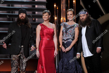 """Stock Image of From left, """"Duck Dynasty"""" cast members Jase Robertson, Missy Robertson, Korie Robertson and Willie Robertson speak onstage at The 47th Annual CMA Awards, on at Bridgestone Arena in Nashville, Tenn"""