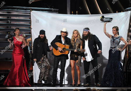 Stock Picture of Hosts Carrie Underwood and Brad Paisley onstage with Korie and Jase Robertson (L) and Willie Robertson and Missy Robertson (R) of Duck Dynasty at The 47th Annual CMA Awards, on at Bridgestone Arena in Nashville, Tenn